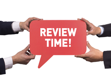 Two men holding red speech bubble with REVIEW TIME! message